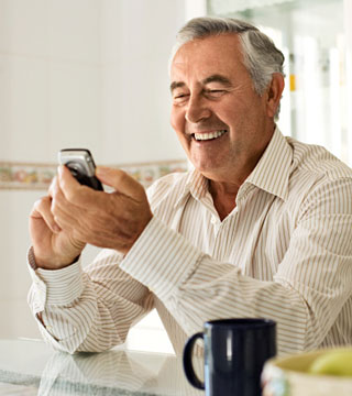 Smiling man using smart phone
